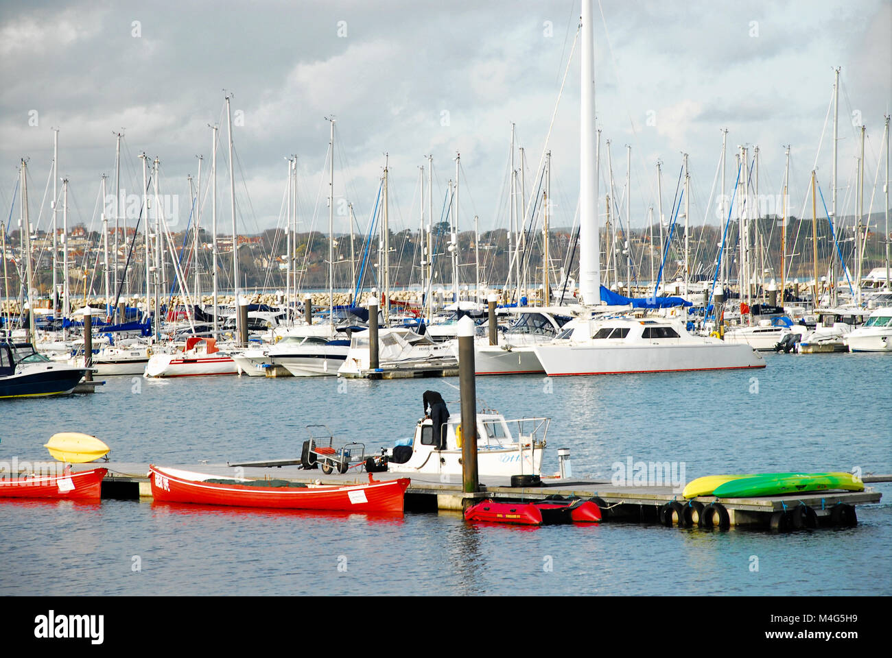 Portland, Dorset. 16th February 2018. People maintain their boats in sunny Portland harbour, witha high of 8 degrees - Stock Image