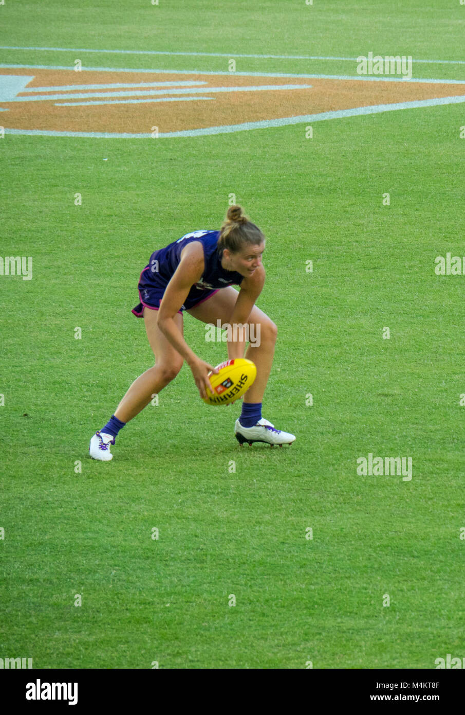 AFL Fremantle Football Club Women's team playing against Collingwood in front of a record attendance at Optus - Stock Image