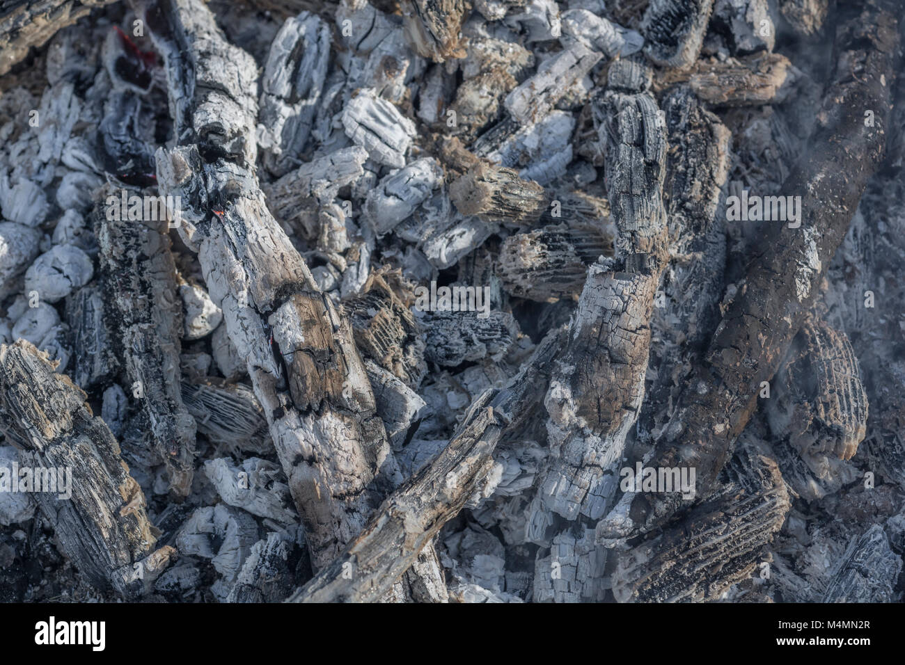 Embers of a wood burning fire. - Stock Image