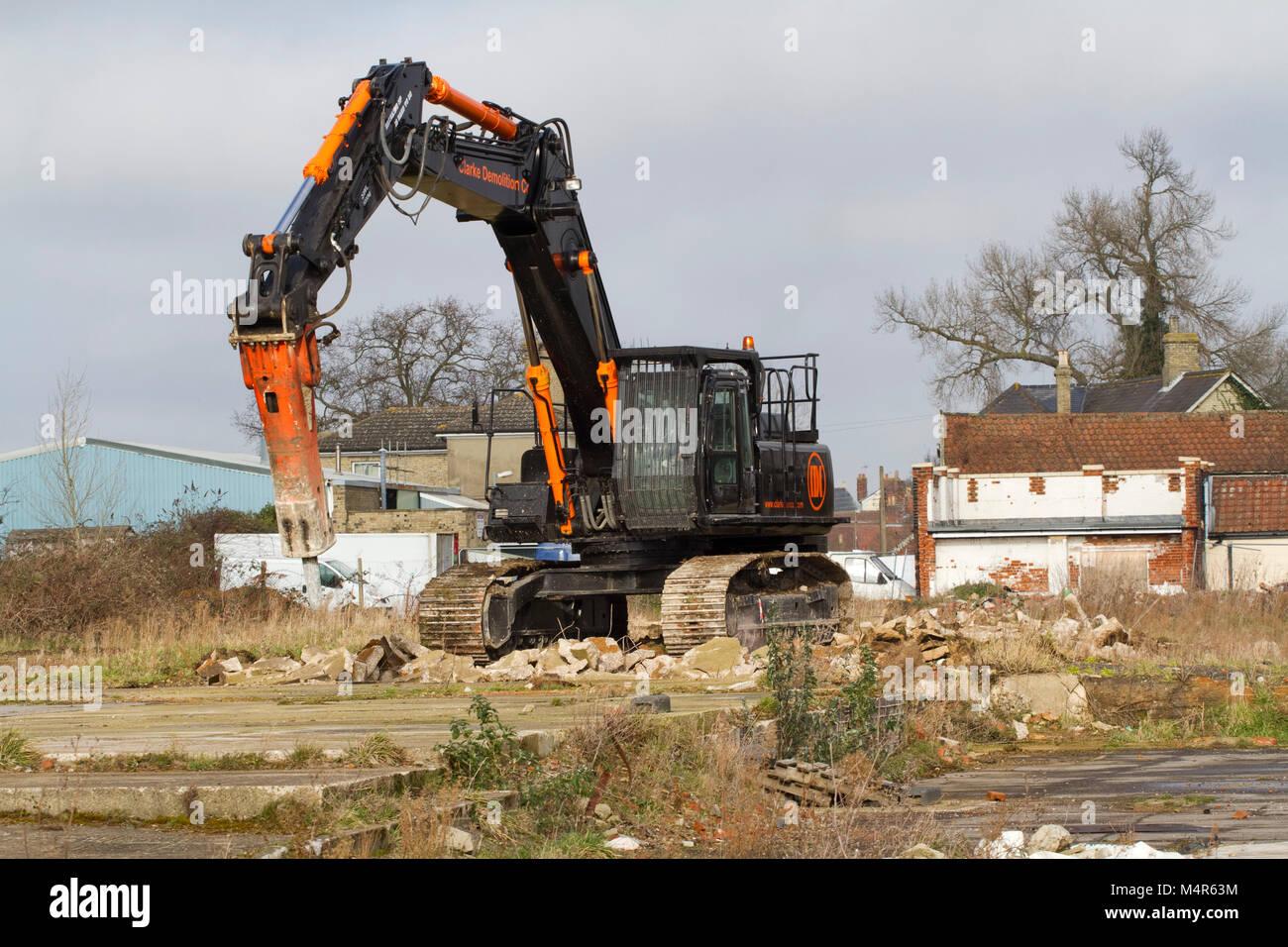 Large tracked machine breaking up concrete - Stock Image
