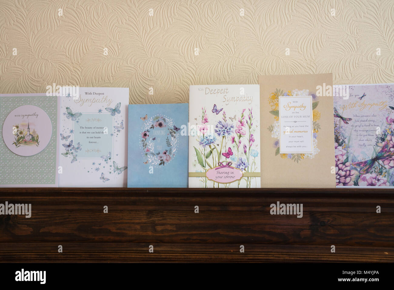 Row of sympathy cards on a mantelpiece - Stock Image