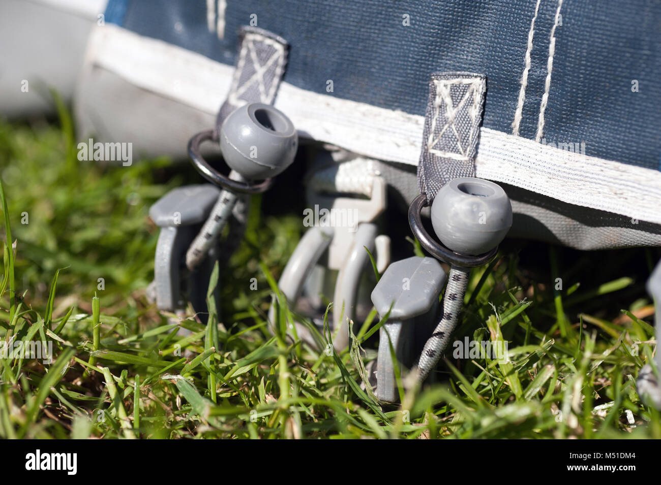 caravan awning ground pegs holding down acrylic caravan awning to the ground - Stock Image