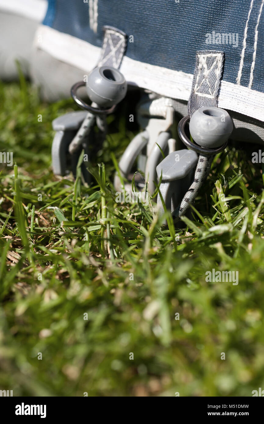 caravan awning pegged to the ground on grass - Stock Image