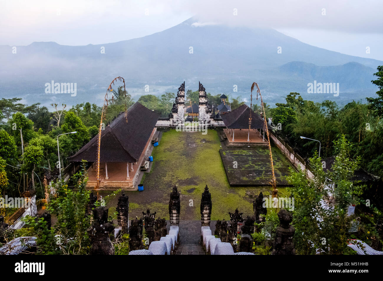 Balinese split gateway ('candi bentar') and outer sanctum, with Mt. Agung in the distance, Pura Lempuyang - Stock Image