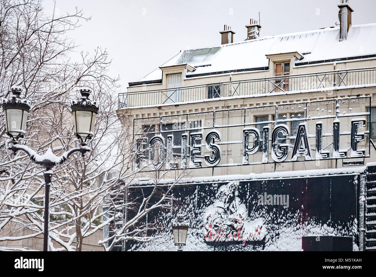 Snow covered Folies Pigalle in Paris France - Stock Image