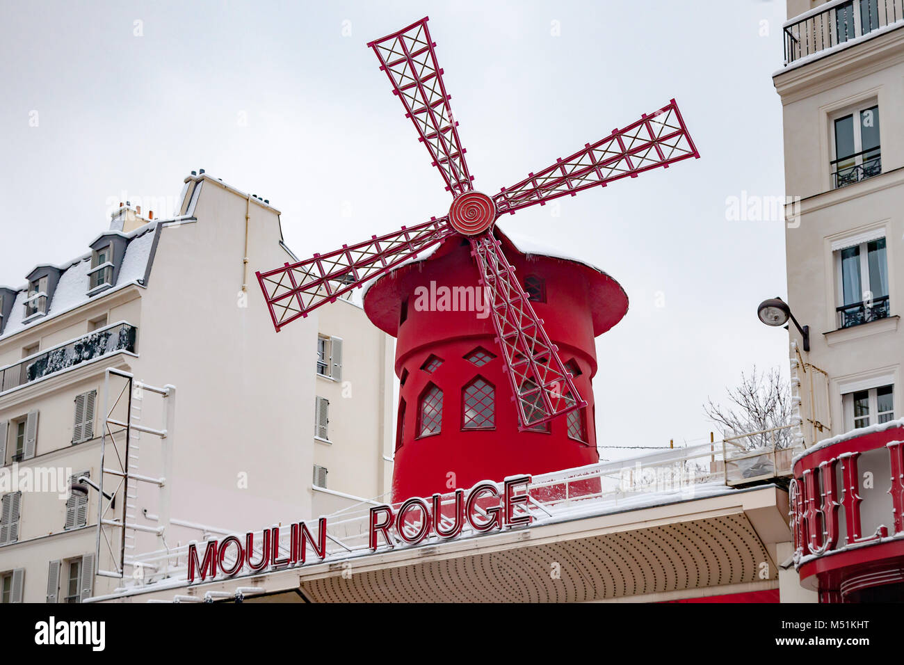 Snow covered Moulin Rouge in Pigalle Paris - Stock Image