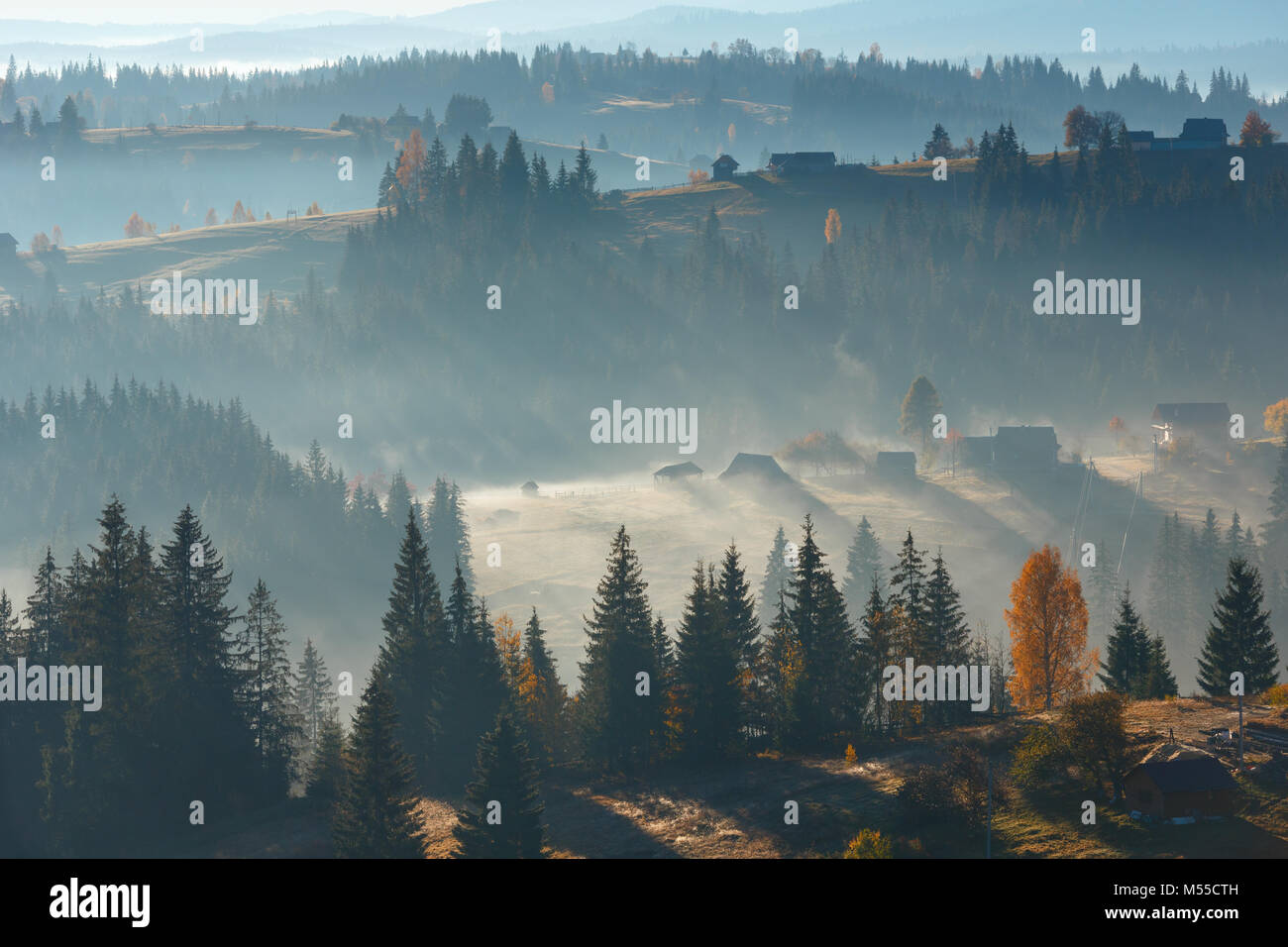 First rays of sun in Carpathians. - Stock Image
