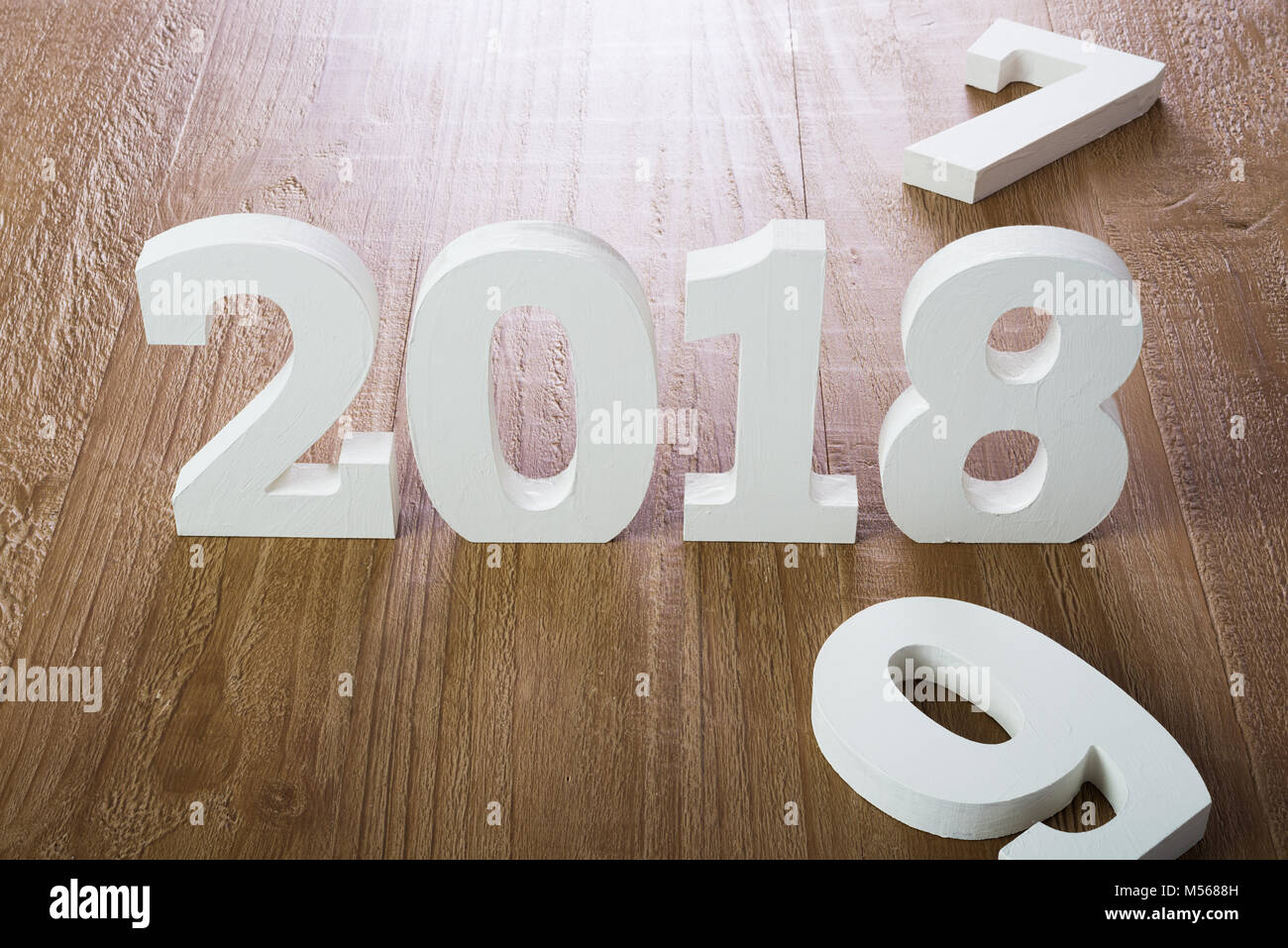 White digits 2018 on wooden background - Stock Image