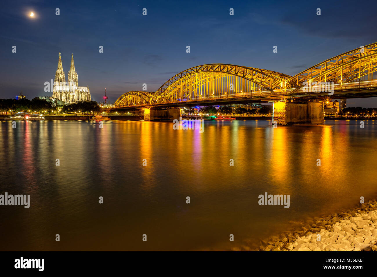 Cologne Cathedral and Hohenzollern Bridge at night, Germany - Stock Image