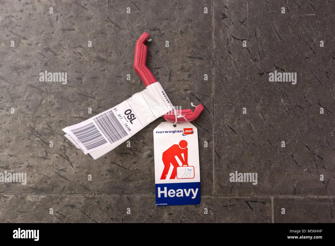 Baggage handle broken with Heavy tag in Oslo Airport, Gardermoen, Oslo, Norway Stock Photo