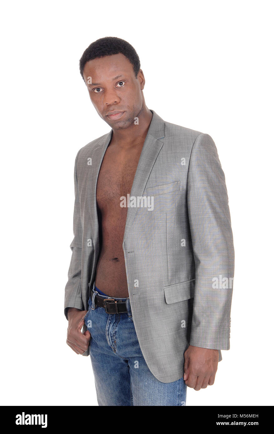 African man standing with jacked shirtless - Stock Image