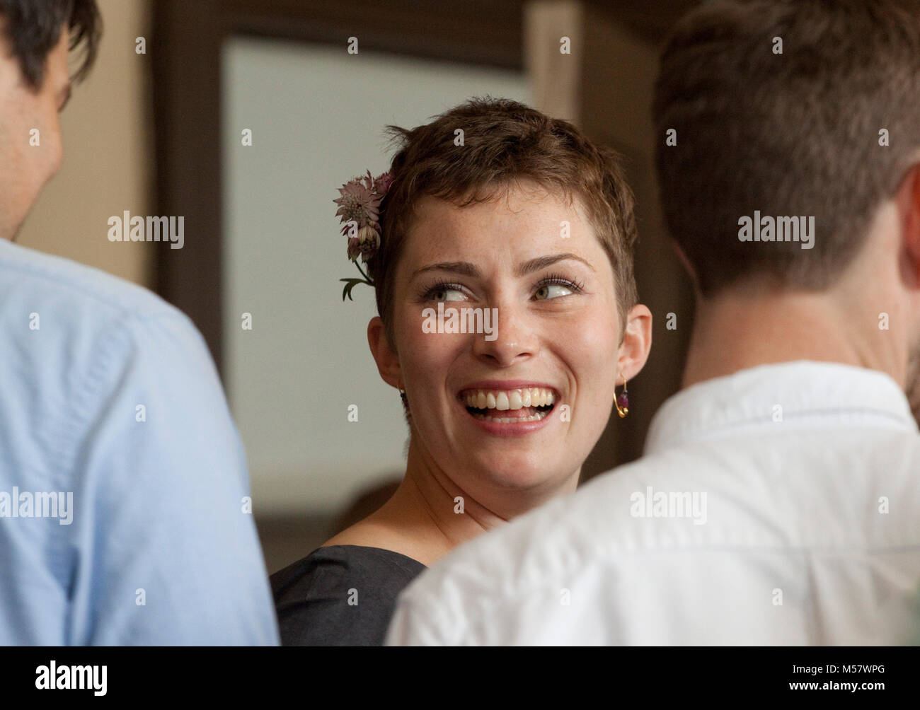 A pretty young woman looks sideways - Stock Image