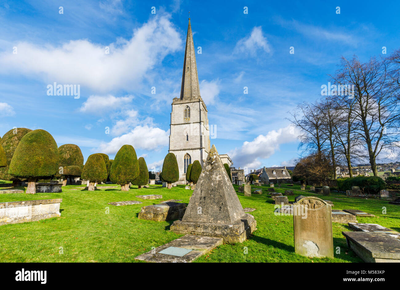 Churchyard of St Mary's Parish church, Painswick, an unspoilt village in the Gloucestershire Cotswolds, with - Stock Image