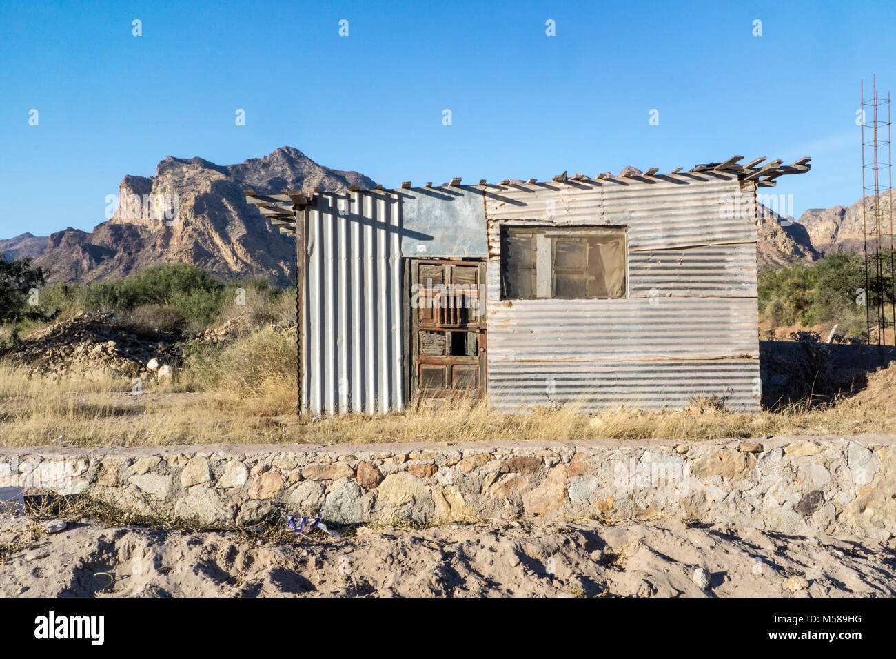 old fisherman's shack on Sonora desert coast near llaSan Carlos with eccentric patchwork of odd pieces galvanized - Stock Image