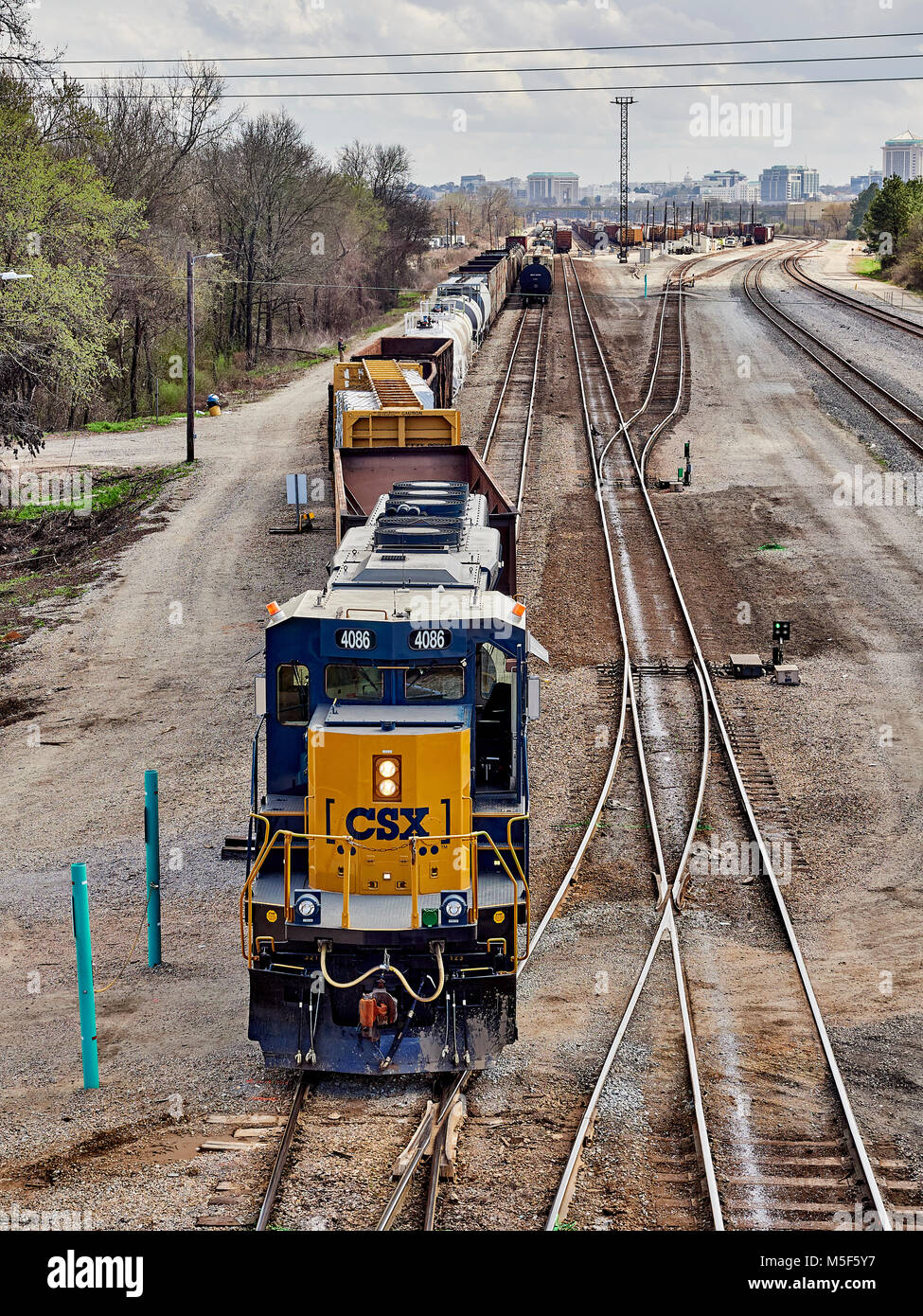 CSX Corporation locomotive engine 4086 moving freight or rail cars in the switching yard of CSX Transportation in - Stock Image