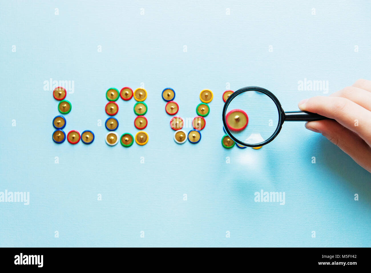 Word Love From Pins Collection Of Stationery Multicolored Buttons Under Magnifier Love Theme
