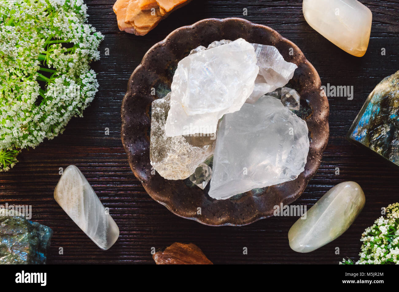 Lunar Stones, including Moonstone, Girasol and Labradorite on Dark Table - Stock Image
