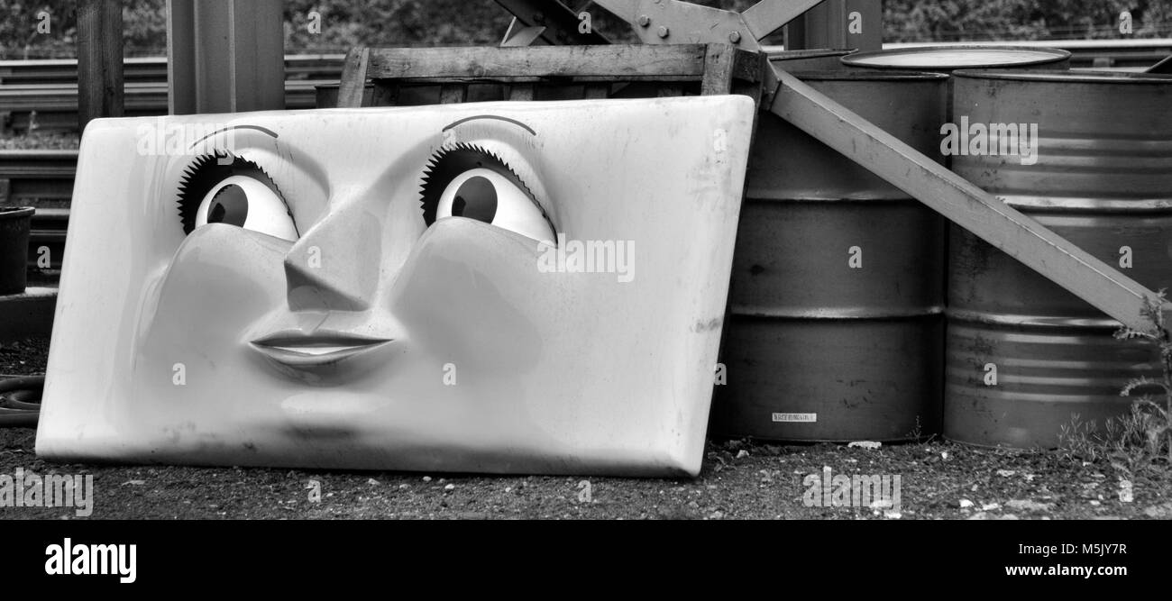 disused thomas the tank engine face sored in old railway yard - Stock Image