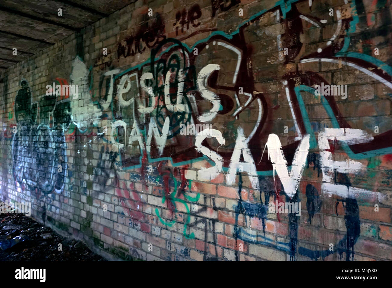grafitti on old air raid shelter wall sizewell suffolk england - Stock Image