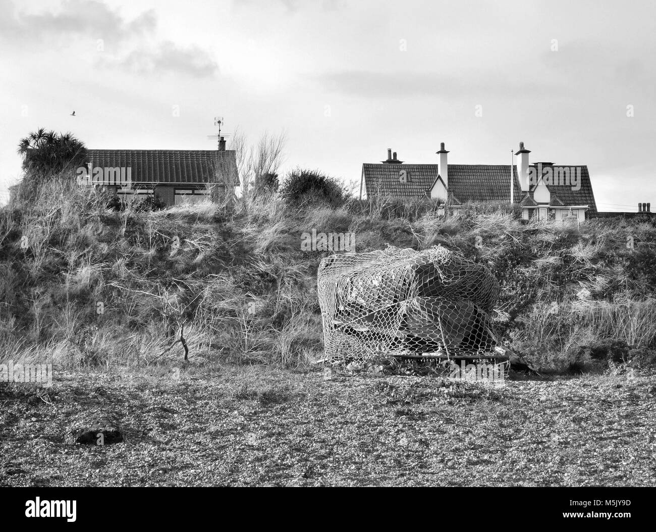 housing at risk from coastal erosion on low cliffs at pakefield suffolk uk - Stock Image