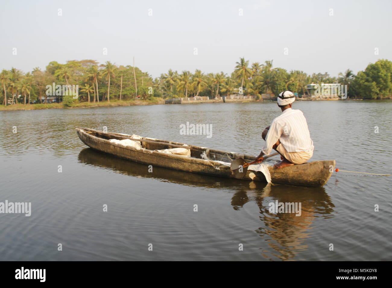 Local fisherman on his board in the backwaters of alapuzha, kerala, India - Stock Image