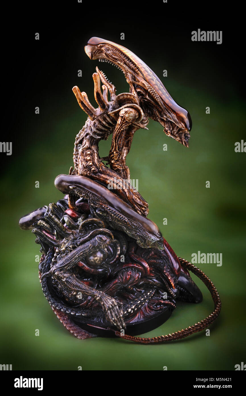 figer hobby toy model alien in green background - Stock Image