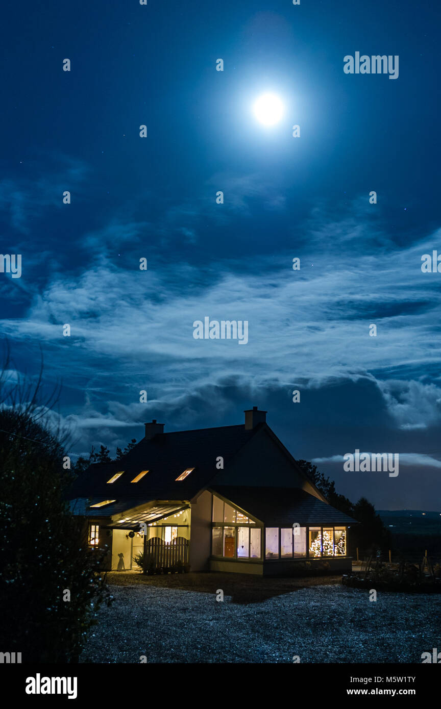 country-house-illuminated-by-moonlight-on-christmas-eve-in-ballydehob-M5W1TY.jpg