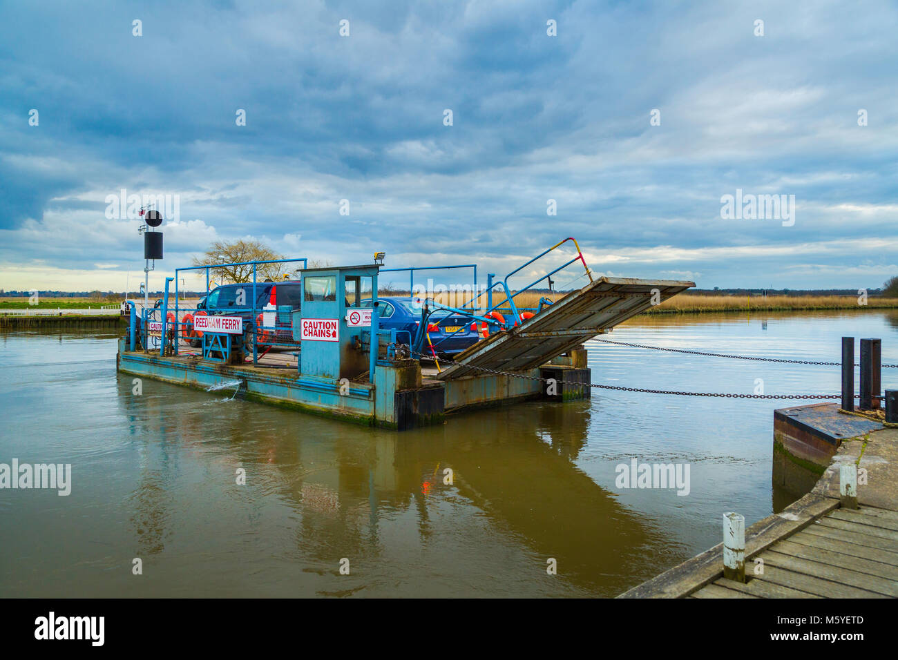 Reedham Ferry across the River Yare saves users a journey of over 30 miles and is the only remaining vehicle ferry Stock Photo