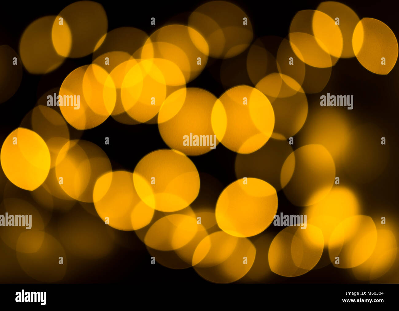 Orange fairy lights as bokeh, London, UK - Stock Image