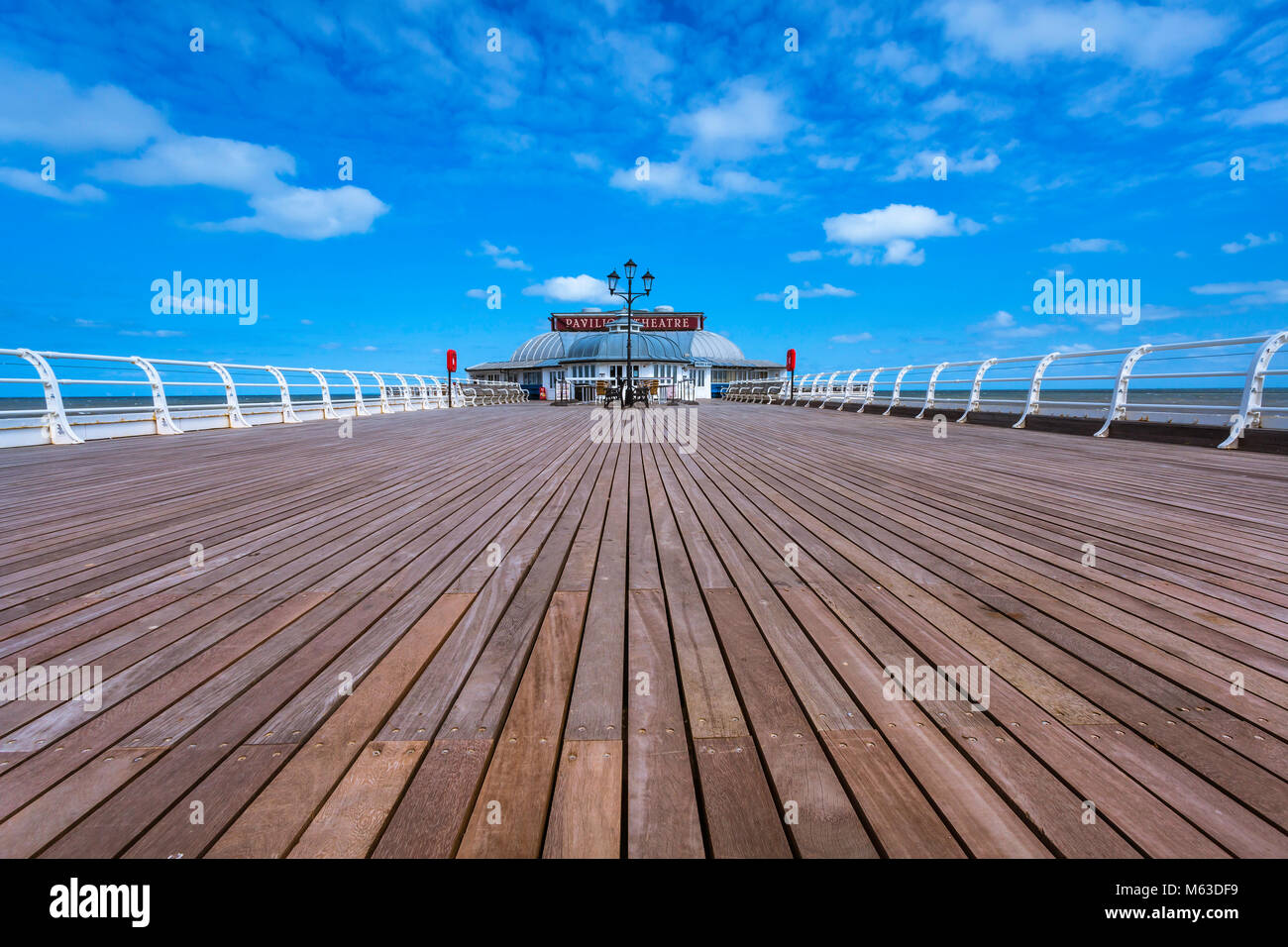 View along Cromer pier to the Pavilion theatre. Stock Photo
