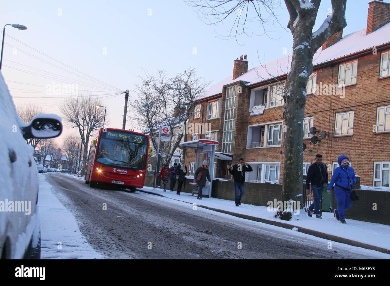 LONDON, UK - February 28:  A bus seen by a bus stop as streets of East London were covered with snow following a - Stock Image