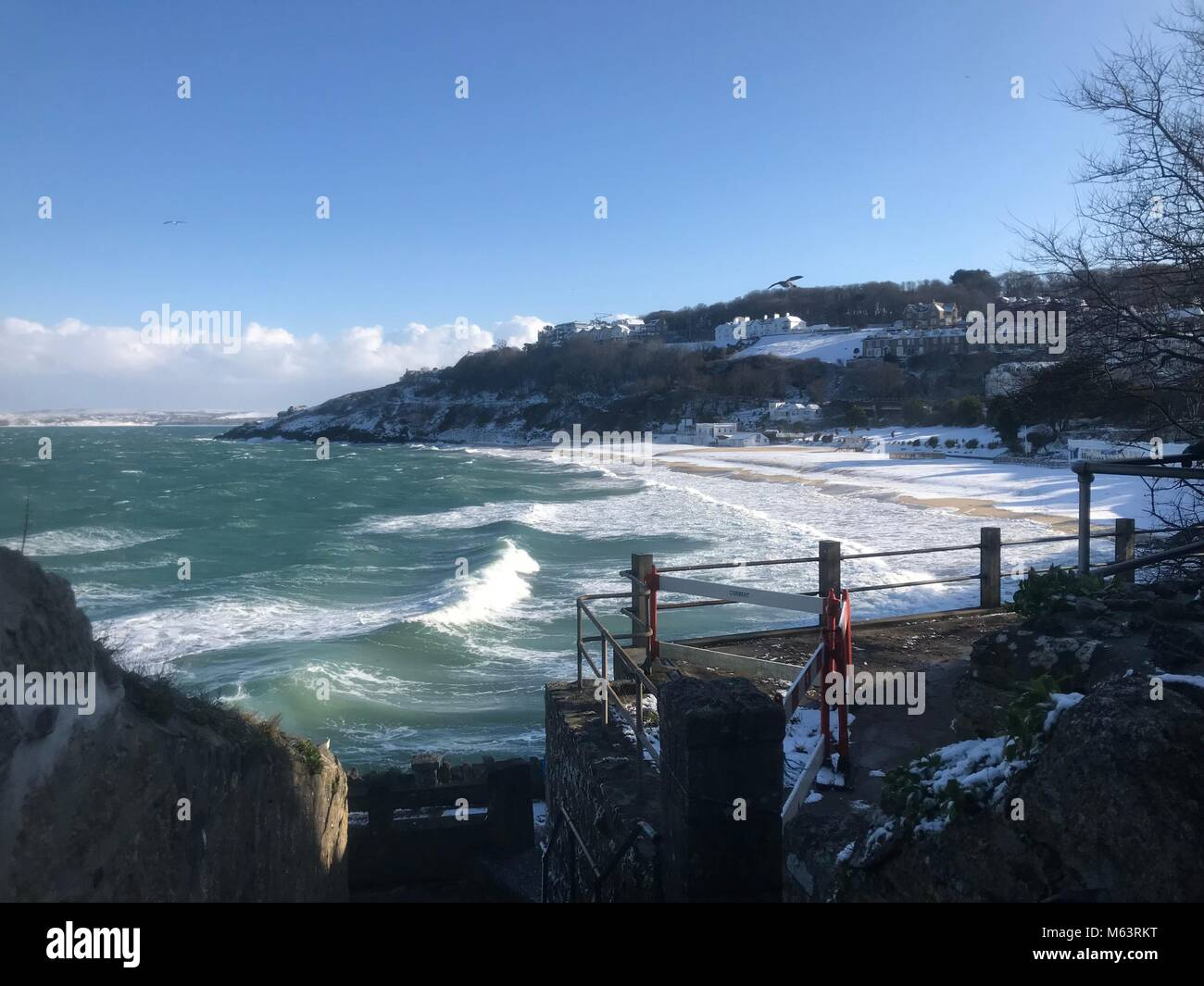 Snow blankets Porthminster Beach as snow storm brings heavy snow fall to St Ives, Cornwall. - Stock Image