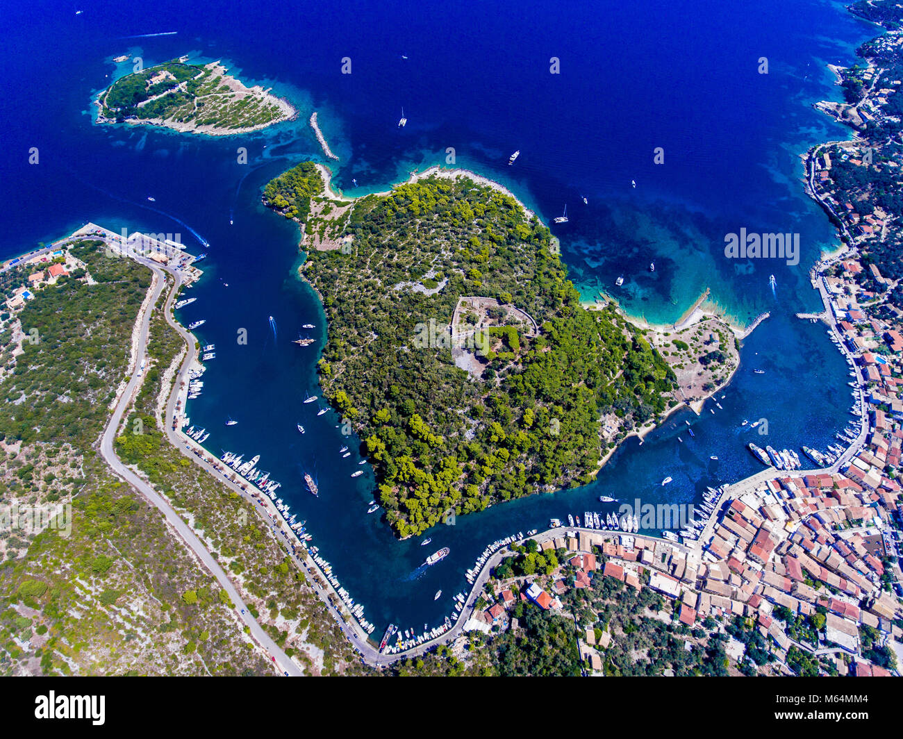 Gaios, capital city of Paxos Island near Corfu, aerial view. Grand canal, old harbor and fortress visible from above. Stock Photo