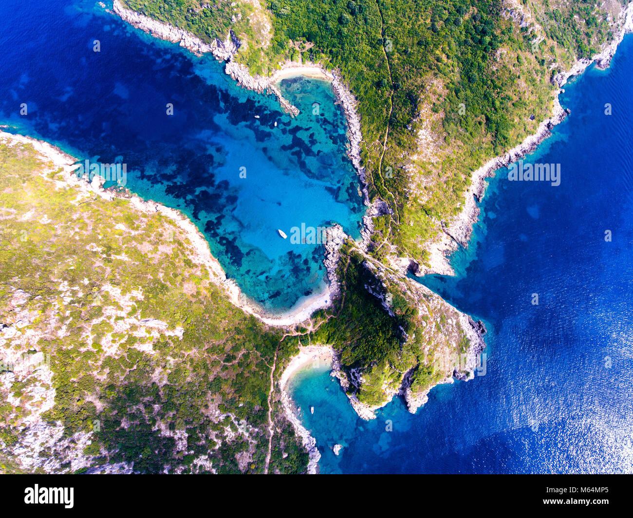 Porto Timoni, on of the hidden beaches of Corfu Island, also known as Kerkyra, near Agios Giorgios beach. Turqoise Stock Photo