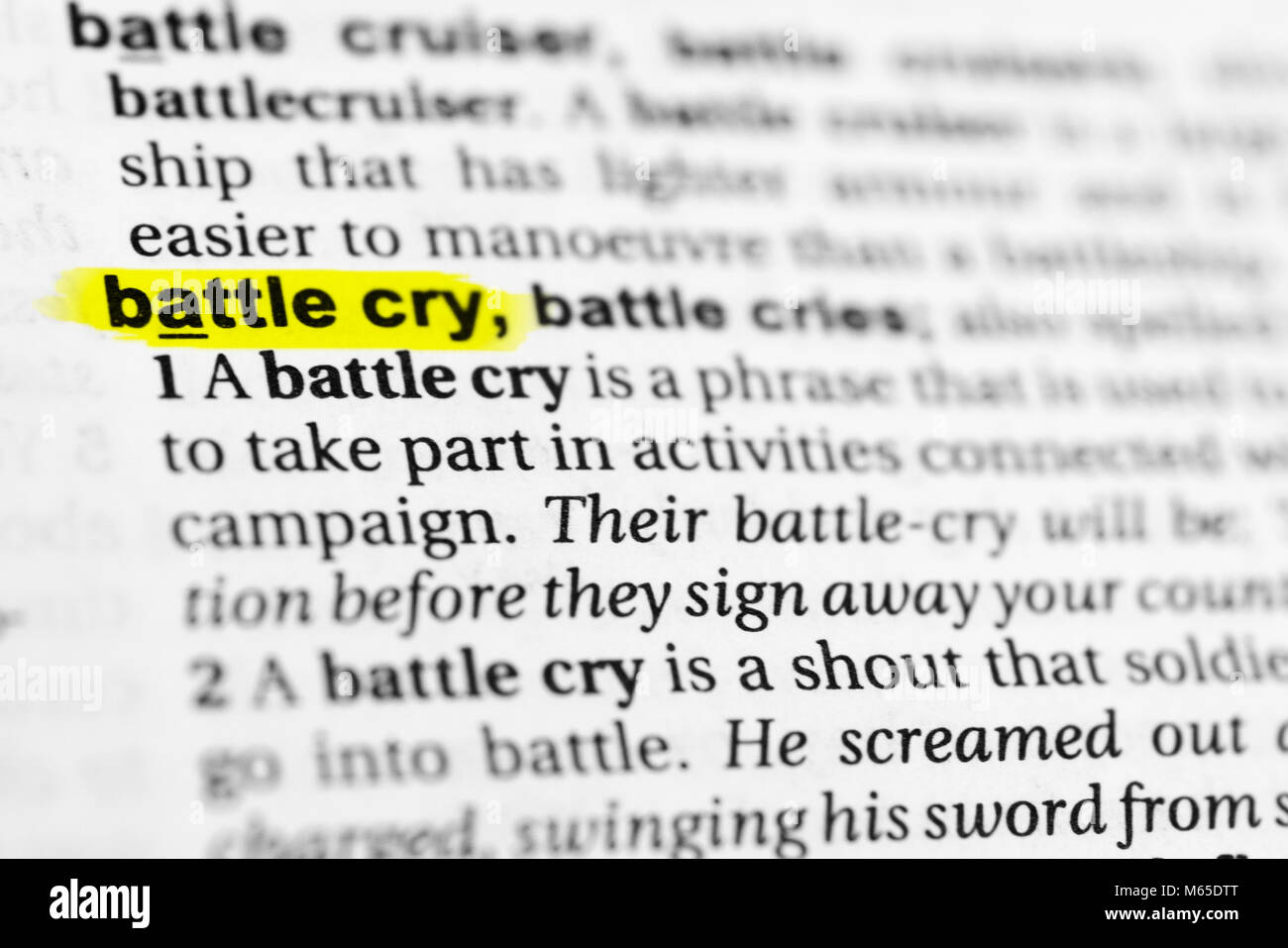 Highlighted English word 'battle cry' and its definition in the dictionary. - Stock Image