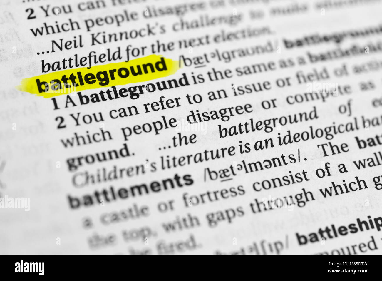 Highlighted English word 'battleground' and its definition in the dictionary. - Stock Image