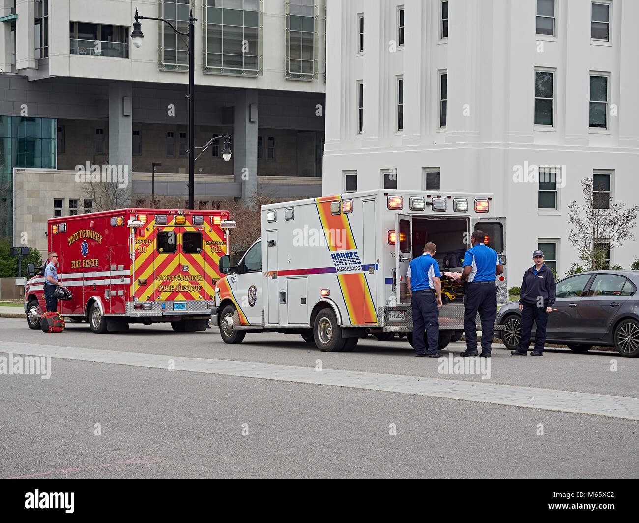 Haynes Ambulance crew load a patient into a waiting ambulance for transport to a local hospital in Montgomery Alabama, - Stock Image
