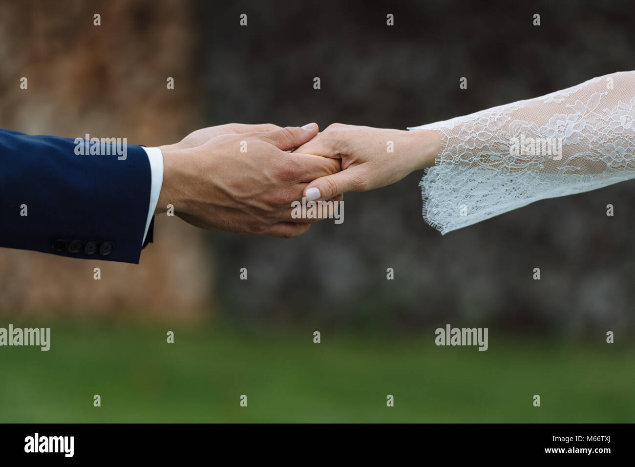 Symbol picture love, wedding, partnership, Wedding couple, groom and bride reach out their hands - Stock Image