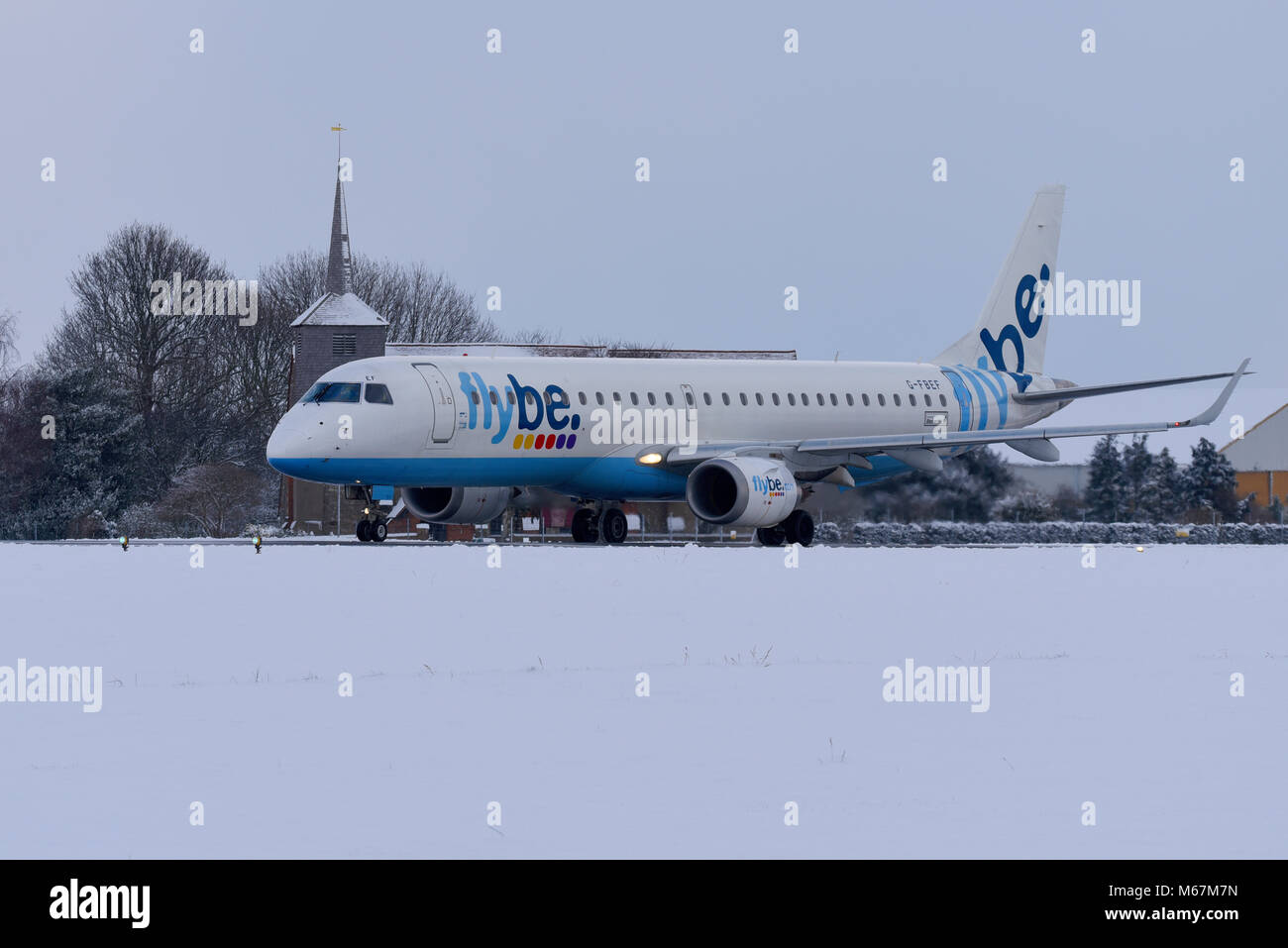 Snow covered airport. Flybe Embraer ERJ-195 taxiing out at London Southend Airport in snow during the beast from Stock Photo