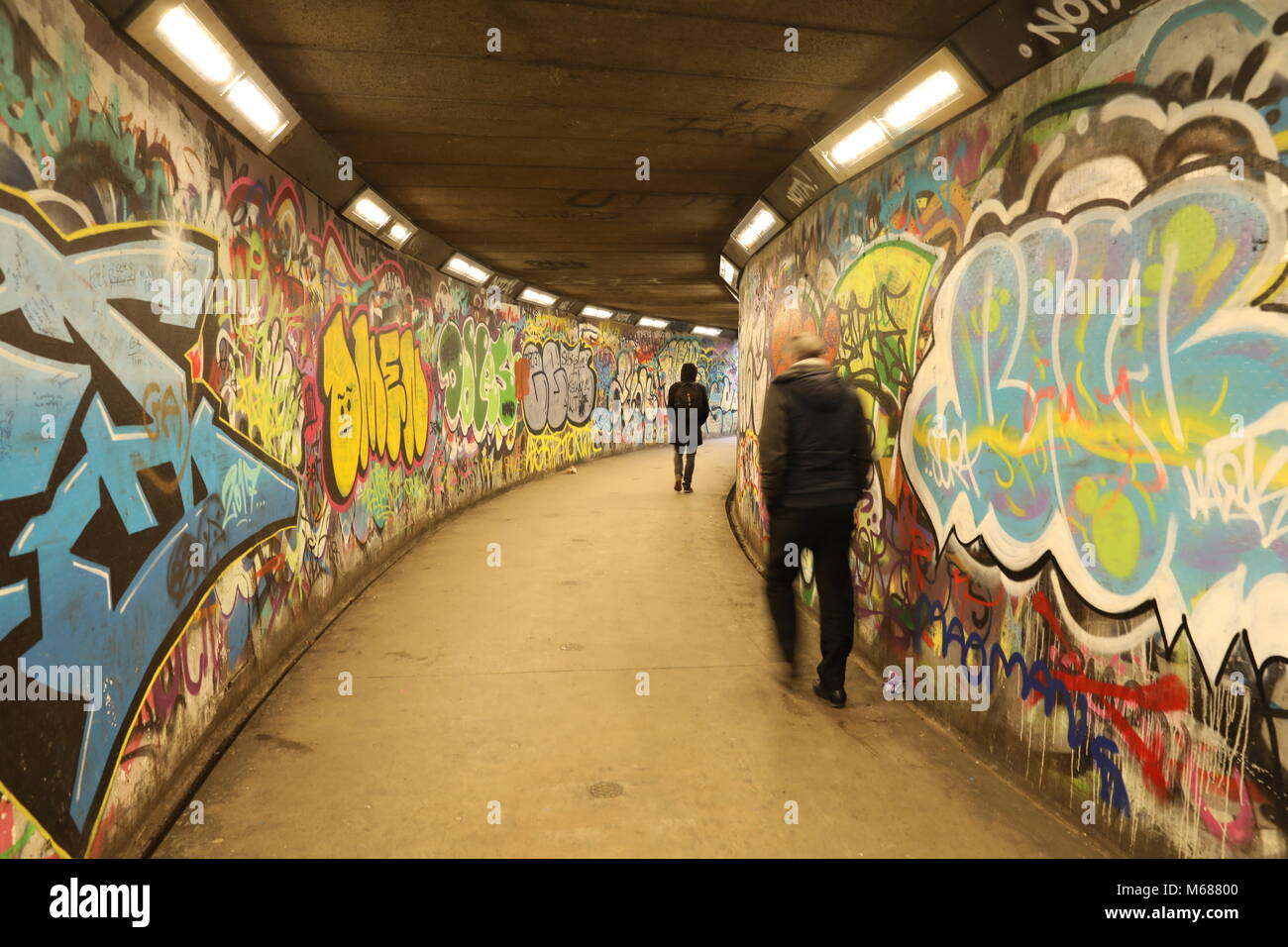 Man walking to the exit of a subway Stock Photo: 175973504 - Alamy