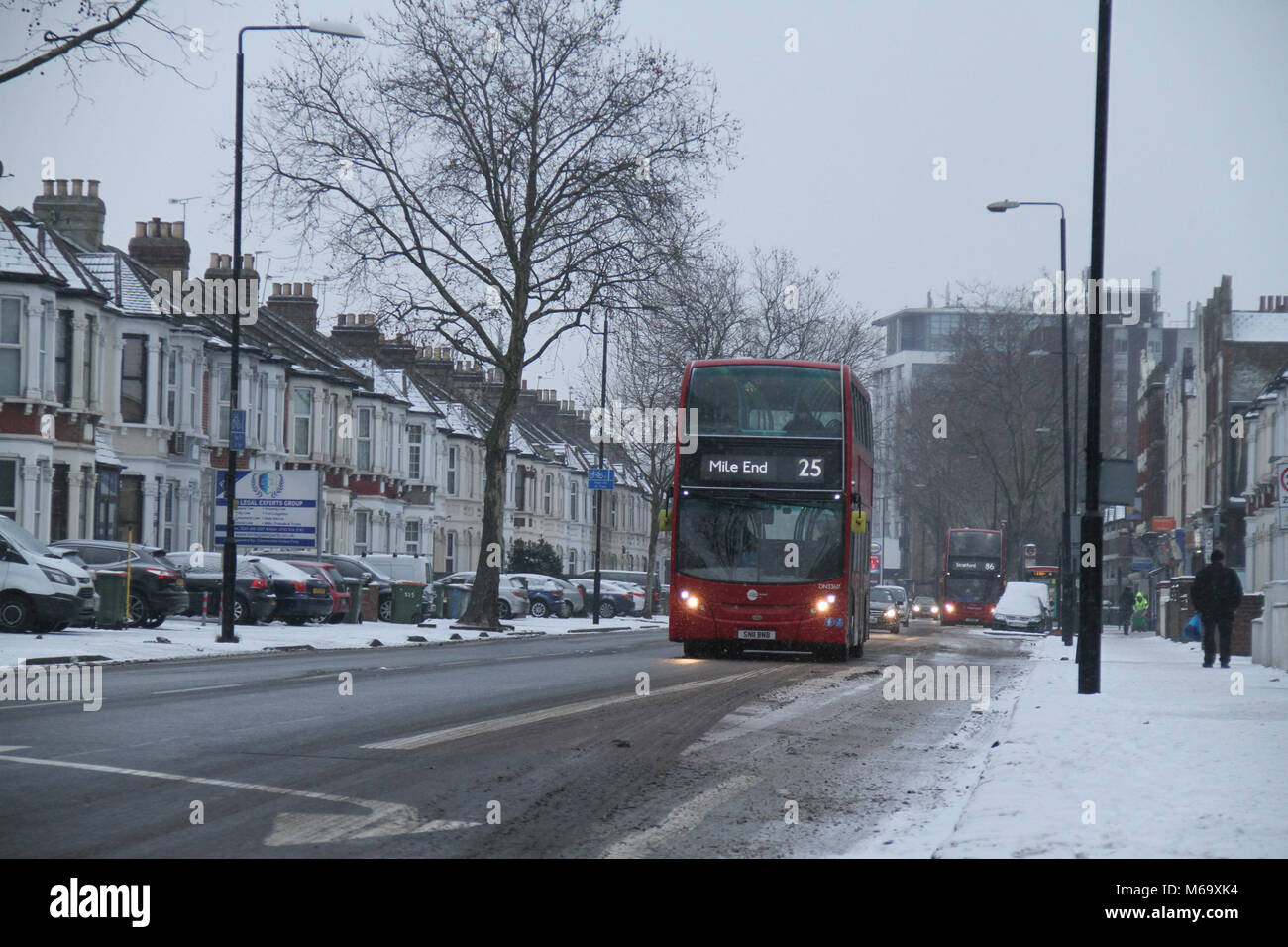 London, UK. 1st Mar, 2018. A London red bus on a gritted Romford Road partly were covered with snow after heavy - Stock Image