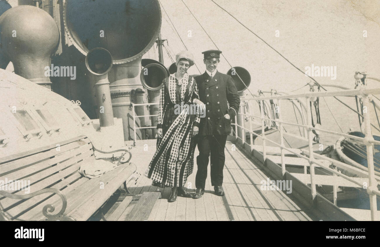 Antique c1900 photograph, woman and crewman aboard a steamship. - Stock Image