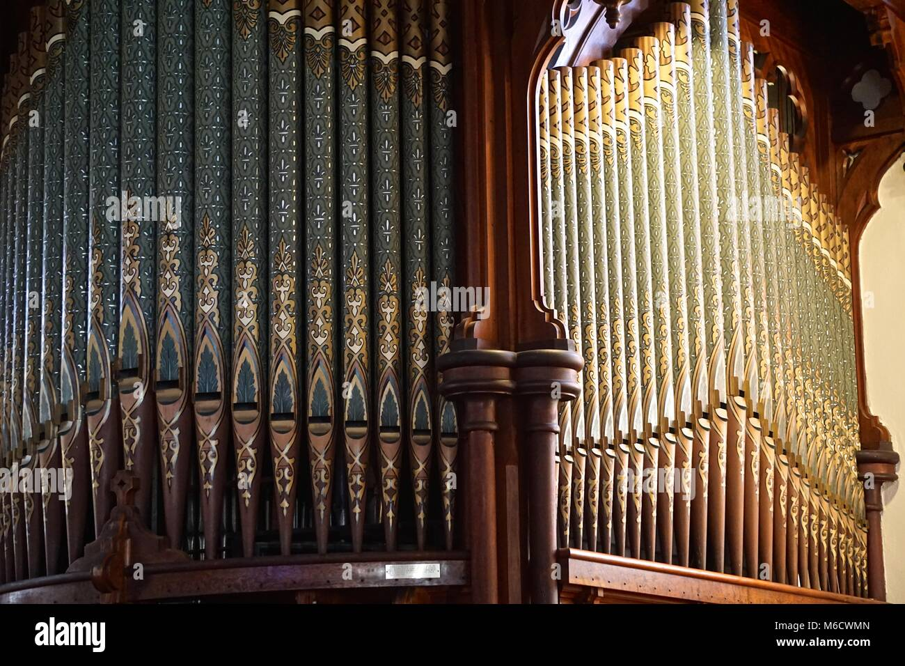 Intricate designs on the organ pipes in St. Peter's Episcopal Church, in Fernandina Beach, on Amelia Island, Florida. - Stock Image