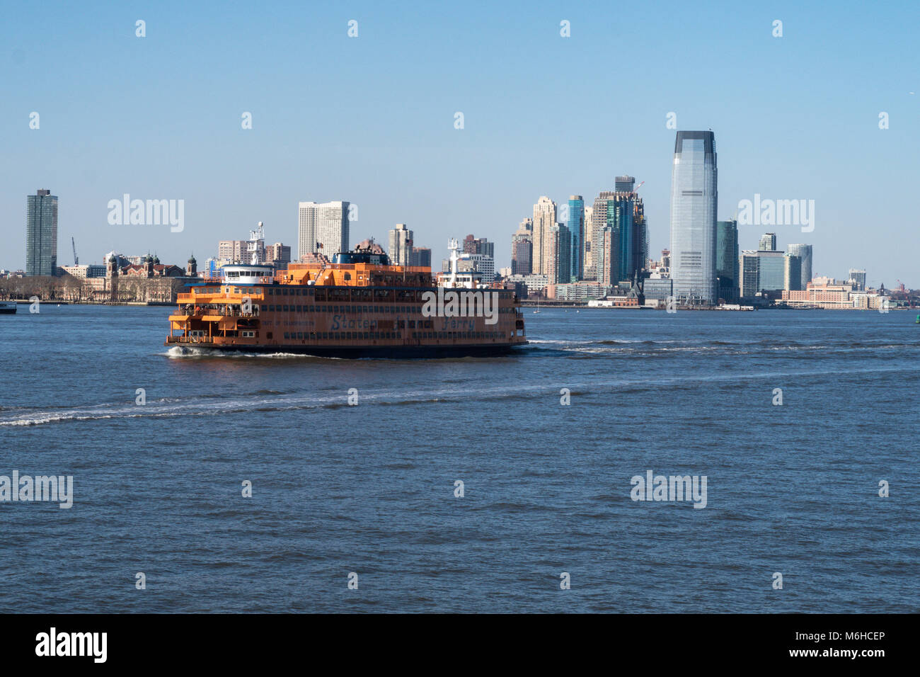 The Skyline of New Jersey and a Staten Island Ferry is seen from New York Harbor, NYC, USA - Stock Image