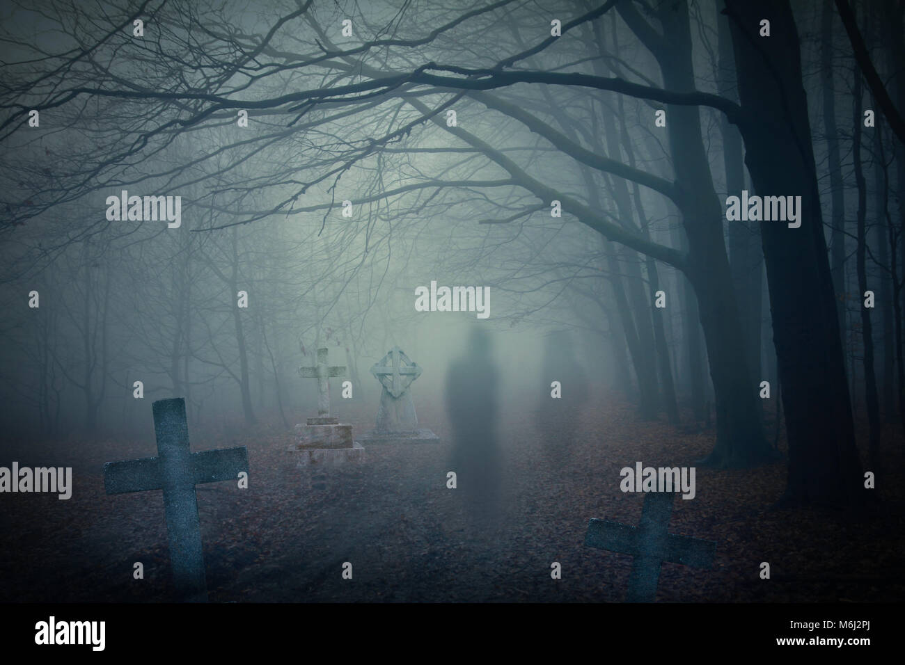 ghosts in haunted forest - Stock Image