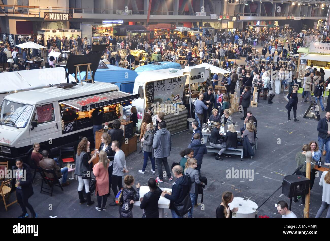 Visitors at the Spaanse Worst Lust and the Zilt en Zalig food trucks in the Europe Complex (Europahal) at the time - Stock Image