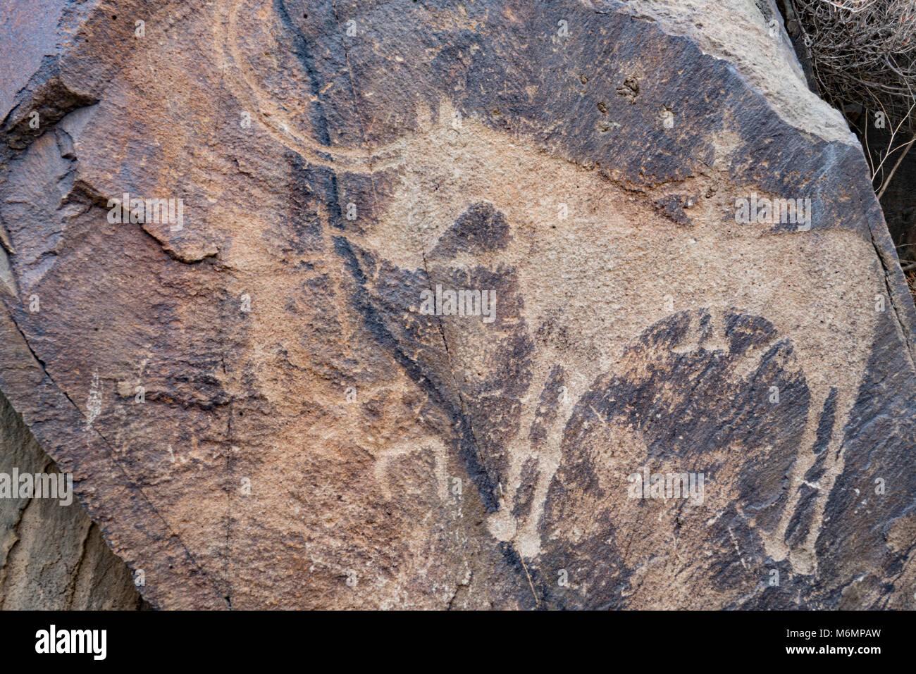 Petroglyphs at Tambaly Achaeological Landscape, Kazakhstan, Tambaly Gorge, Chu-Lii MOuntains Bronze Age rock art, Stock Photo