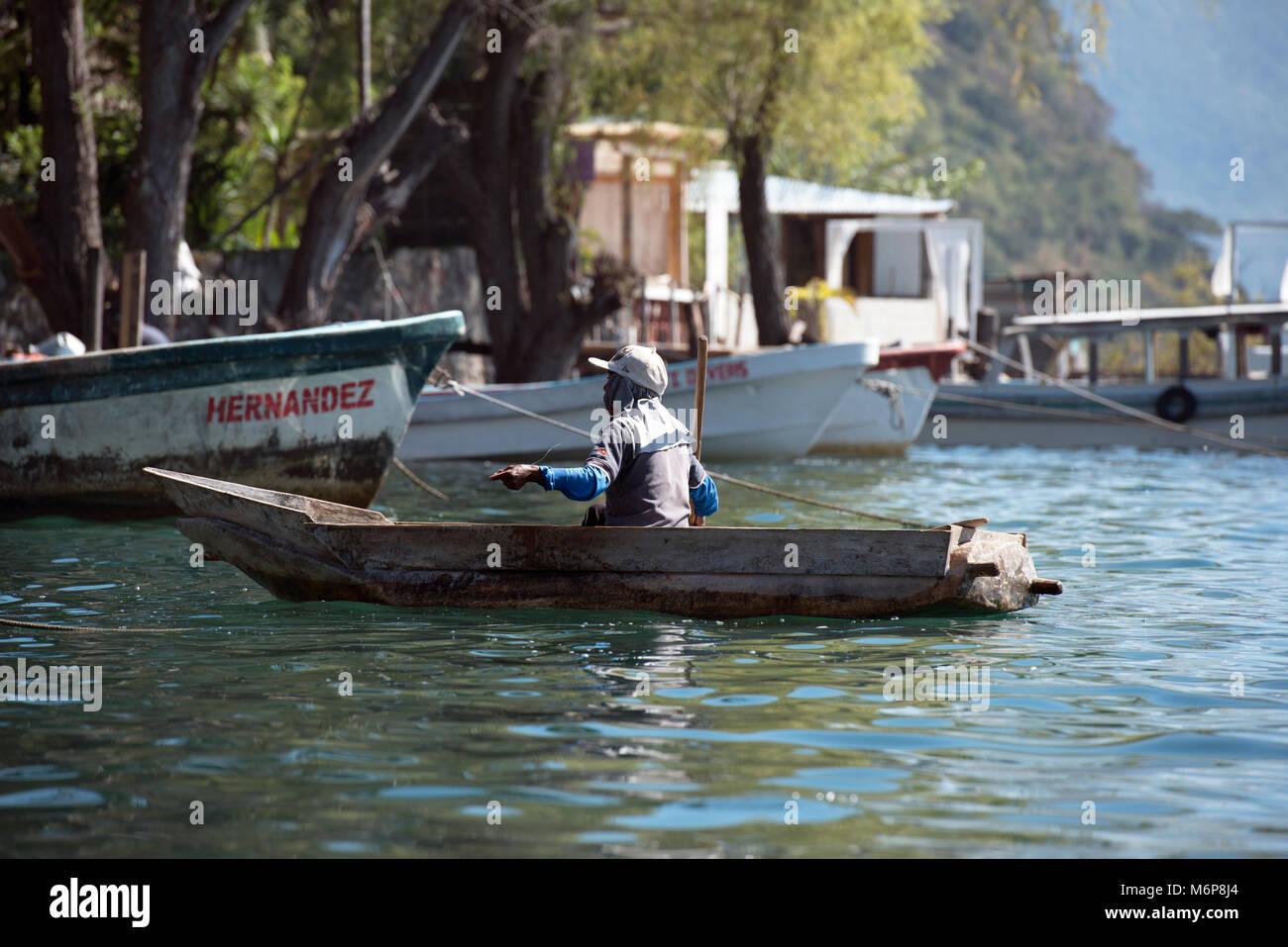An indigenous, ethnic Mayan man making his living from fishing. Lake Atitlán, Sololá Department, Guatemala. - Stock Image