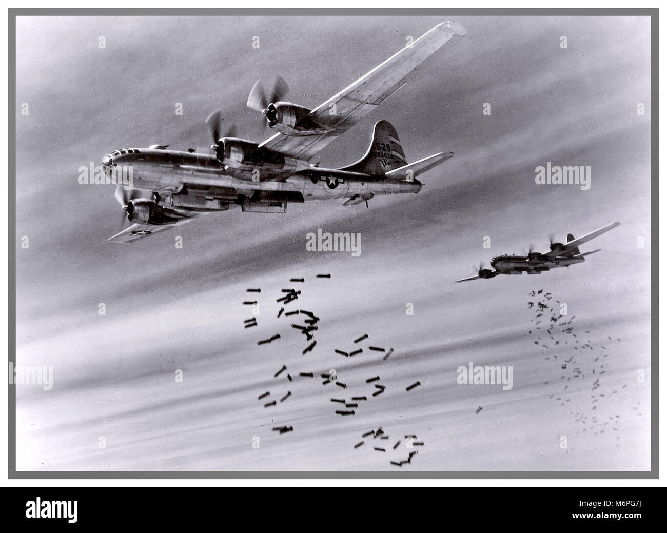 WW2 USAF Boeing B-29s drop bombs over Rangoon, Burma. Attack against the invading forces of The Imperial Army of - Stock Image