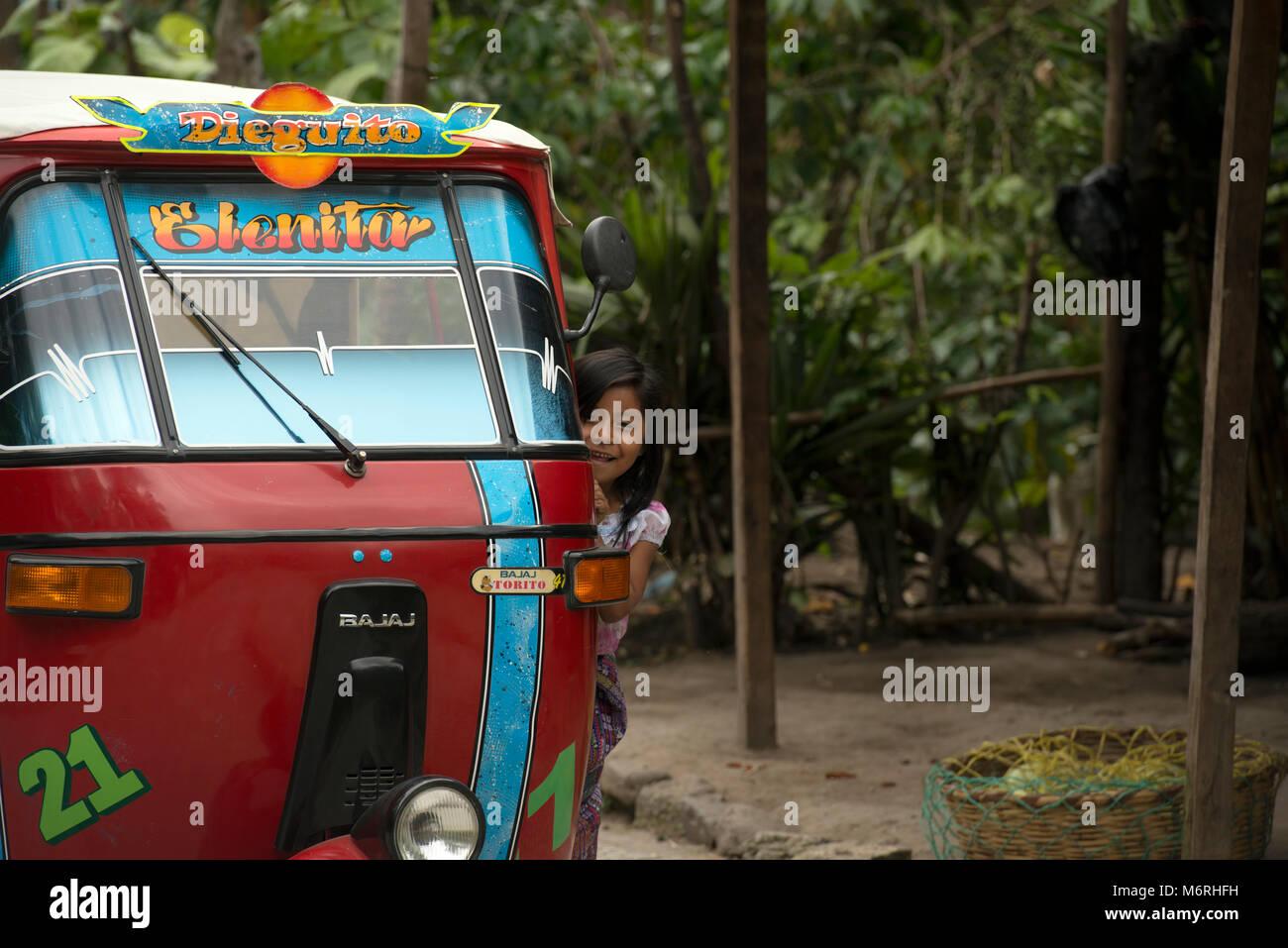 A young indigenous, ethnic Kaqchikel Mayan girl in a taxi. San Marcos La Laguna, Guatemala. - Stock Image